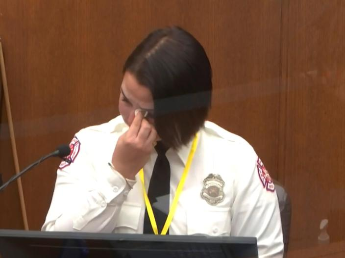 In this image from video, Minneapolis Firefighter Genevieve Hansen wipes her eyes as she testifies Tuesday, March 30, 2021, in the trial of former Minneapolis police Officer Derek Chauvin, in the May 25, 2020, death of George Floyd at the Hennepin County Courthouse in Minneapolis, Minnesota.