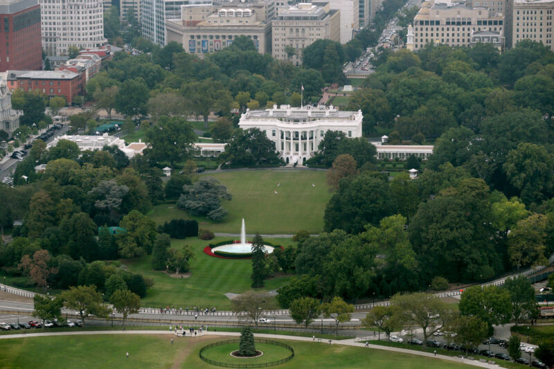The White House, the South Lawn, and part of the Ellipse are seen from the observation deck of the Washington Monument on October 1, 2014, in Washington, DC.